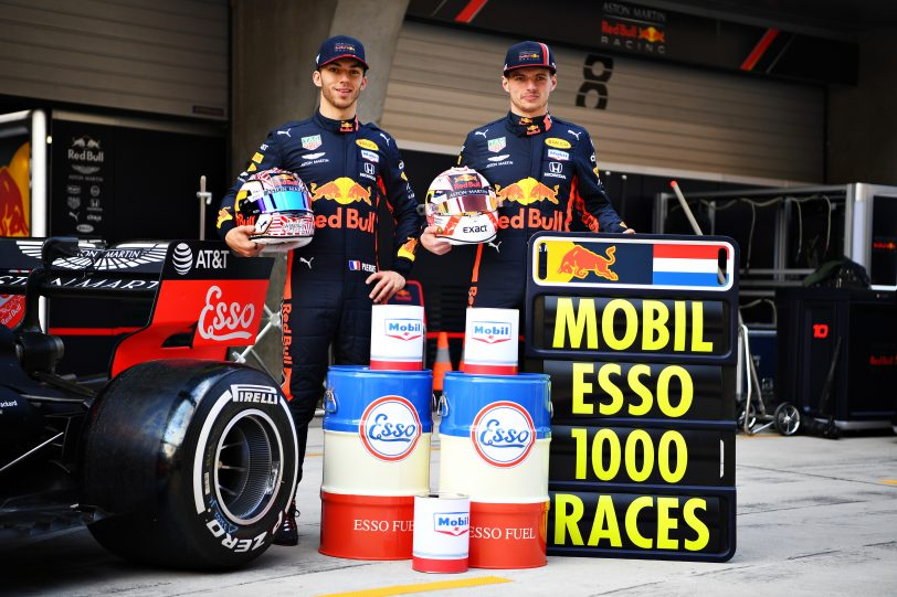 Max Verstappen of Netherlands and Red Bull Racing and Pierre Gasly of France and Red Bull Racing pose for a photo with heritage Esso and Mobil cans to commemorate the 1000th Formula One race during previews ahead of the F1 Grand Prix of China at Shanghai International Circuit on April 11, 2019 in Shanghai, China. (image courtesy Red Bull Racing)